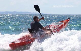 Man canoeing on the ocean - Mozambique Holiday - Guinjane Lodge